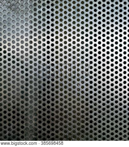 Perforated Metallic Grid, Industrial Background. Steel Plate With Holes