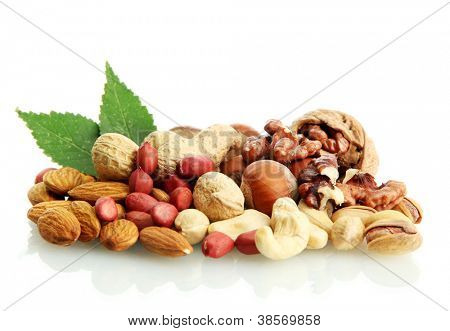 assortment of tasty nuts with leaves, isolated on white