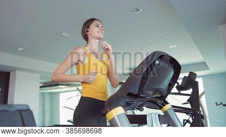 Portrait Of Fit White Healthy Woman, Caucasian Person, Running Or Jogging On Treadmill, And Training