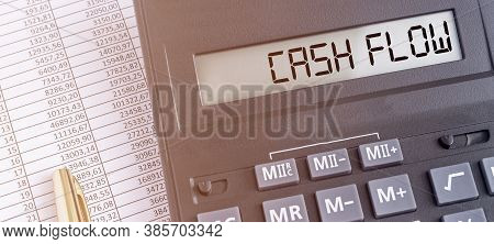 Word Cash Flow On Calculator Extra Close Up With Accounting Financial Documents. Banner