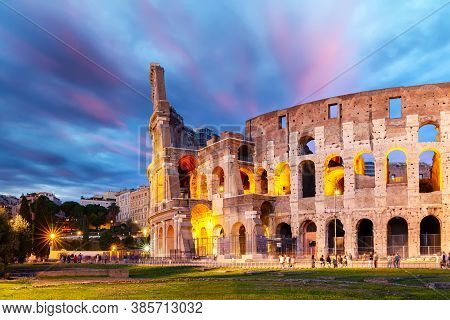 The Colosseum In Rome, Italy At Colorful Sunset Twilight. The World Famous Colosseum Landmark In Rom