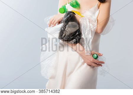 Partial View Of Woman Holding Empty Bottles And Plastic Bags On White, Ecology Concept
