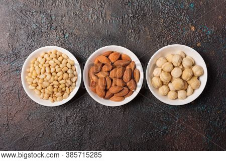 White Bowls With Nuts As Snack Or Ingredient For Tasty Dessert, Meal