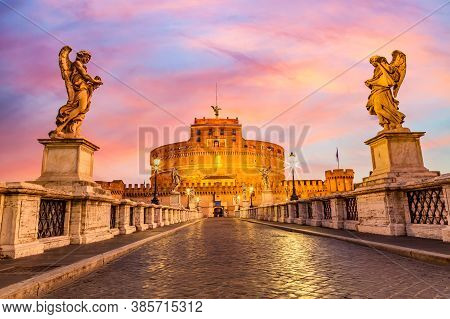 Castel Santangelo And The Santangelo Bridge During Twilight Sunset In Rome, Italy