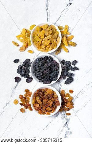 White Bowls With Various Raisins As Ingredient For Tasty Dessert