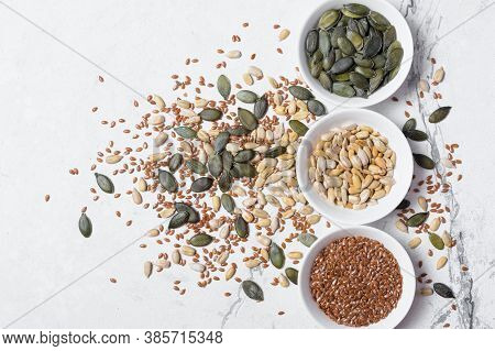 White Bowls With Different Seeds As Snack, Ingredient For Oil, Mix For Healthy Salad