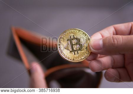 Hand With Bitcoin, Male Hand Hold A Cryptocurrency Bitcoin