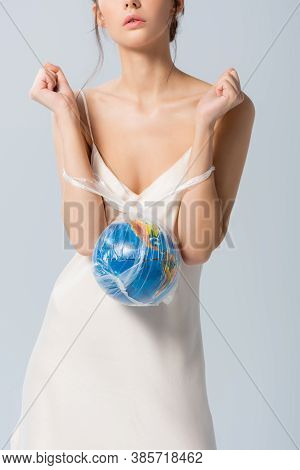 Partial View Of Young Woman In Silk Dress Holding Plastic Bag With Globe Isolated On White, Ecology