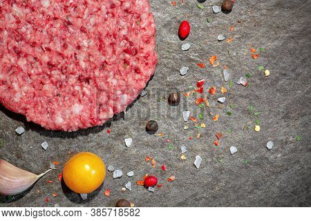 Raw Beef Burger With Spices On The Table Close-up, Minced Hamburger, Raw Meat For Frying,
