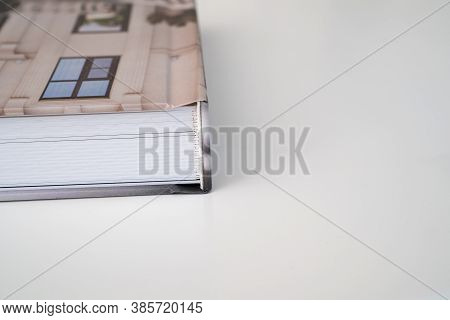 Close Up. Photo Book Binding. Storing Photos From A Photo Session In A Photobook. The Result Of The