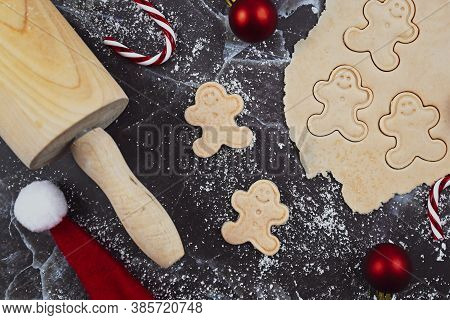 Concept For Baking Christmas Cookies With Rolled Out Cookie Dough, Cookies In The Shape Of Happy Gin