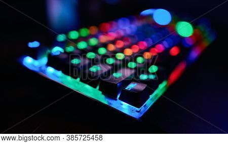 Premium Gaming Rgb Led Backlit Keyboard. Mostly Green, Blue And Red. Side View.