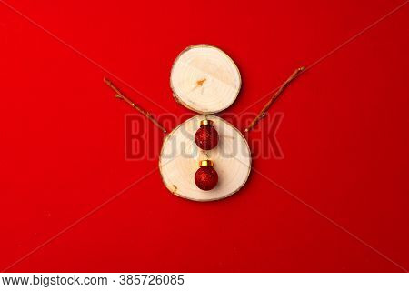 Wooden Snowman With Red Baubles Christmas Decoration On Red