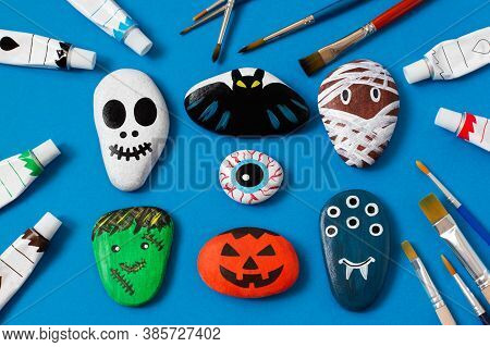 Drawing On Stones Halloween Characters. Art Project For Children. Diy Concept. Halloween Party Decor