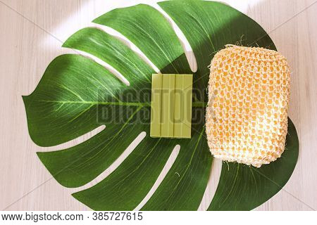 Olive Soap And Natural Washcloth On A Decorative Leaf, Concept Of Ecology And Body Care With Natural