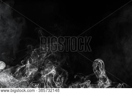 Conceptual Image Of White Color Smoke Isolated On Dark Black Background, Halloween Design Element Co