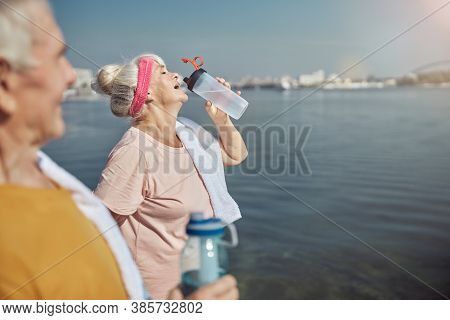 Woman Replenishing Lost Electrolytes After The Workout