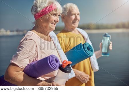Happy Sporty Pensioners Gazing Into The Distance