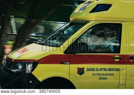 Split Croatia September 2020 Panning Shot Of A Yellow Ambulance Passing By In Split, Inscription On