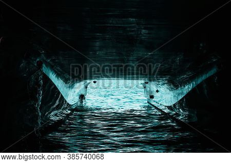 Underside Of A Double Hull Passenger Boat, Water Reflecting Off The Painted Hull. Canal Of Light Thr