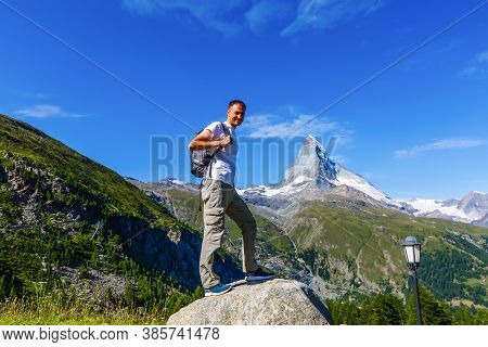 Matterhorn With People In The Front, A Man Hiking To Matterhorn