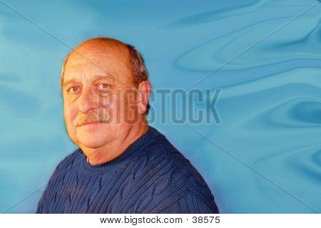 Older Man In Blue Sweater