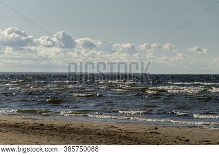 Waves Running With Foam On The Fine Sand Of The Baltic Sea, Summer Landscape On The Sea In August, C