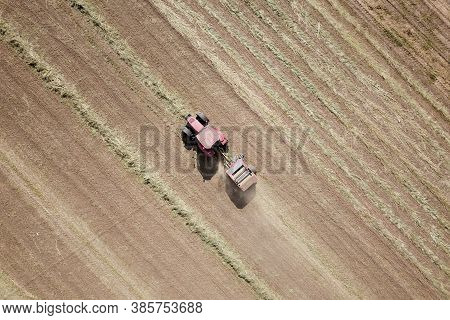 Red Tractor Baling Hay, On The Fields