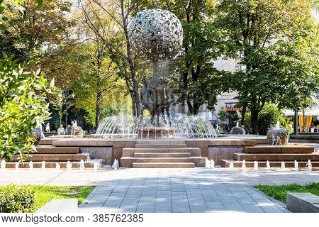 Moscow, Russia - September 6, 2020: People Near Water Fountain Adam And Eve In Green Garden On Pyatn