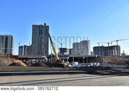 Work Of Truck Crane On Bridge Project Works. Roundabout Traffic Bridge Construction And Highway Ramp