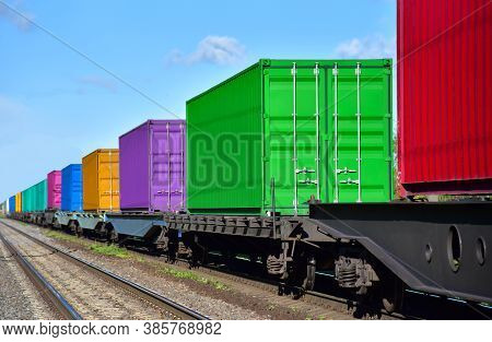 Cargo Containers Transportation On Freight Train By Railway. Intermodal Container On Train Car. Rail