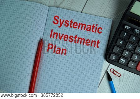 Systematic Investment Plan Write On A Book Isolated On Office Desk.