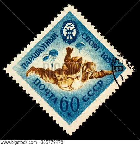 Moscow, Russia - September 15, 2020: Stamp Printed In Ussr (russia) Shows Parachutist In Sky, Free F