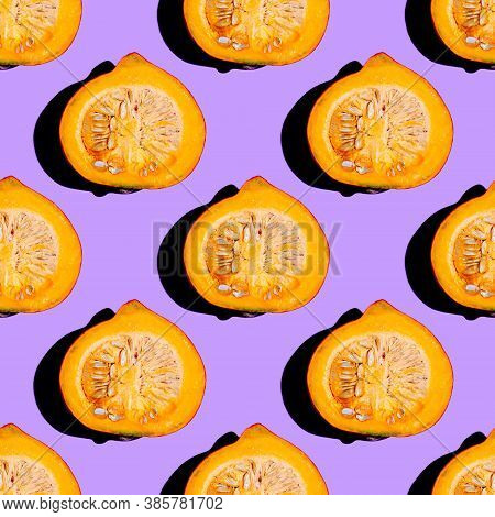 Creative Seamless Food Pattern Of Halved Orange Pumpkin On Neon Purple Background. Conceptual Modern