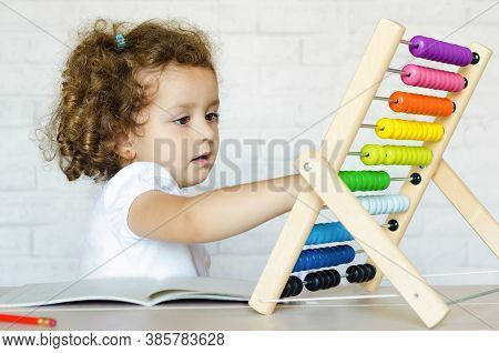 Preschooler Child Learning To Count. Girl Playing With Mathematical Abacus. Kid And Math. Developmen