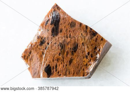 Closeup Of Sample Of Natural Mineral From Geological Collection - Unpolished Mahogany Obsidian Rock
