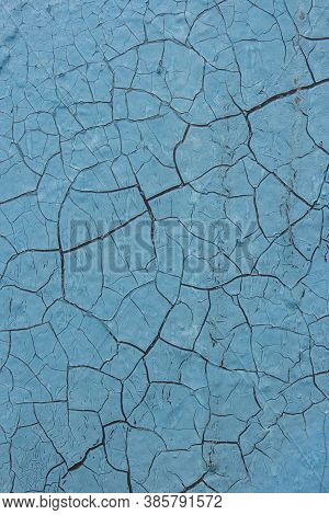 The Old Cracked Blue Paint On A Wall Surface. Peeling Paint On Wall Seamless Texture. Pattern Of Rus