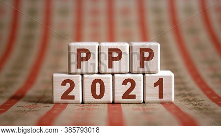 Ppp 2021 Text On Wooden Cubes On A Monochrome Background With Reflection.