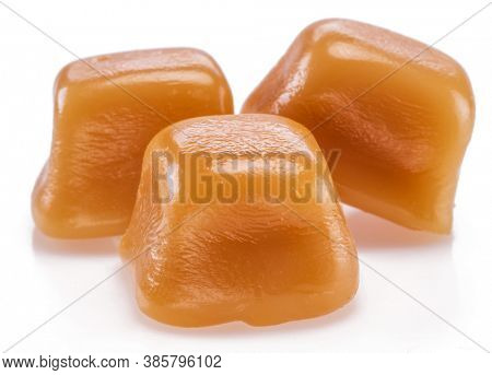 Toffee or candy caramel sweets isolated on white background.