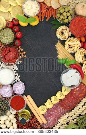 Mediterranean & Italian health food low cholesterol diet with salami, pasta, sauces, tomatoes, vegetables. High in protein, omega 3, antioxidants,dietary fibre & lycopene. Flat lay with border.