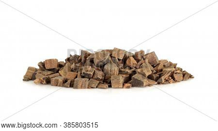 Guaiacum herb bark used in natural herbal medicine on white background. Guaiacum officinale. Can help to heal rheumatism, arthritis, syphilis, breathing problems, skin disorders & is anti bacterial.