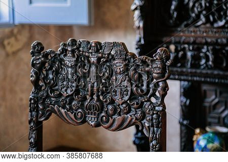 Wooden Renaissance Chair With A Carved Body. Castle Grabstejn, Ancient Medieval Gothic Chateau Near