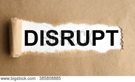 Disrupt. Text On White Paper On Torn Paper