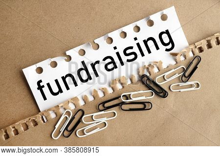 Fundraising. Text On White Paper On Craft Paper Background