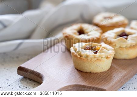 Christmas Homemade Mince Pies On Wooden Paddle Board On White Background