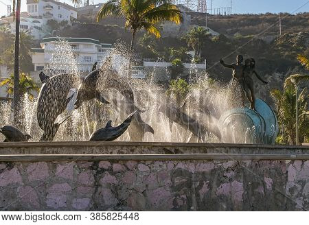 Mazatlan, Mexico - April 23, 2008: Morning Sunlight Plays Through The Waterdrops Of Fountain Of Monu