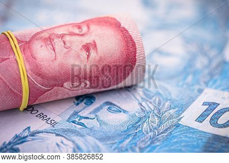 Money From China And Brazil, Banknotes Of One Hundred Reais And Banknotes Of 100 Yuan, Or Renminbi.