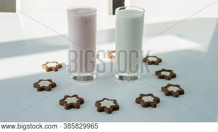 Yogurt In Glass With Figured Cookies In The Form Of Stars,dairy Product On A White Background, Fruit