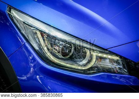 Close-up Led Xenon Headlight Of Blue Modern Car With Halogen Lamp Technology For Illuminate Both Day