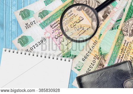 10 Sri Lankan Rupees Bills And Magnifying Glass With Black Purse And Notepad. Concept Of Counterfeit
